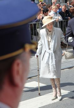"""Queen Fabiola of Belgium attends the wedding event in 2011's (Queen Mathilde's sister)  in a light gray suit, matching tie-neck blouse, pashmina and printed stockings (girl's got style!). To finish her ensemble, she chose a Chanel quilted purse and gray heels. At almost 83 years old, she is still """"working"""" the heels!!!. She just turned 85 on June 11, 2013."""