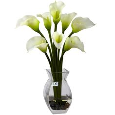 Cream Classic Calla Lily Arrangement - One aspect of the Calla is the combination of strength (their bold stems) and beauty (the lush fluted blooms). Together they create a look that simply cannot be duplicated by any other plant (live or otherwise). This wonderful reproduction Cream Classic Calla Lily Arrangement captures that beauty for the world (or your family and friends) to see, complete with glass vase, river rock, and faux water.