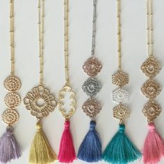 These are the most fun tassel necklaces around. 30 gold plated beaded chain (design 4 comes on a silver plated chain) with your choice of filigree shape and color tassel.