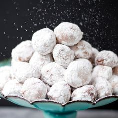 Yeast doughnut holes tossed in powdered sugary goodness!