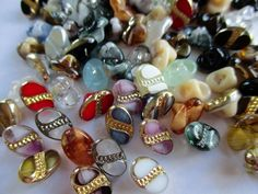 JOB LOT TINY VINTAGE GLASS BUTTONS MULTI COLOURED OVALS 100 pcs. noelhumphrey on eBay.co.uk