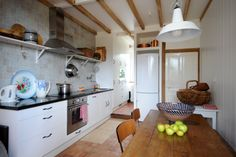 Cosy kitchen with authentic tile floor and modern cooking devices