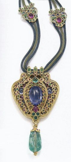 Arts and Crafts necklace, designed by Louis Comfort Tiffany with Meta Overbeck for Tiffany & Co., circa 1918. Composed of gold, sapphires, rubies, emeralds, enamel and silk. Signed Tiffany & Co. Ralph Esmerian Collection. Image source: Bejewelled by Tiffany 1837-1987
