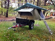 Customer doing some backyard camping with his Tent Topped Compact Dinoot Jeep style off road trailer.  Visit www.dinoot.com for info