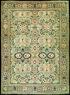 Antique Tabriz Persian rug with olive green