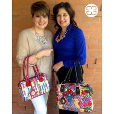 Cori and her sister Lilie , flaunting their Marias! Both, made with huipiles from Quetzaltenango, their hometown!