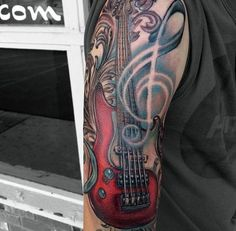 Big 3D like colored bass guitar tattoo on half sleeve area