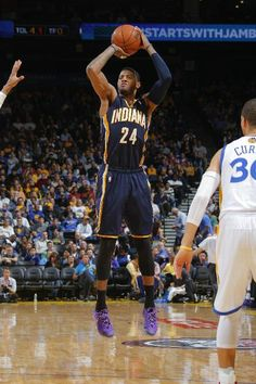 Paul George of the Indiana Pacers shoots against the Golden State Warriors Indiana Basketball, Basketball Photos, Nba Basketball, Golden State Warriors Game, Indiana Pacers, Espn, Athletes, Legends, Lights