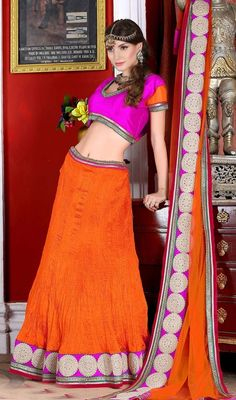 Emblazon the genuine and matchless you dolled up in this orange color satin lehenga choli. This beautiful attire is showing some extraordinary embroidery done with resham and lace work. Upon request we can make round front/back neck and short 6 inches sleeves regular lehenga blouse also. #LatestOrangeShadesOfNetLehengaCholi