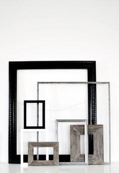 multiple frames leaned on a shelf?