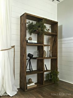 """Create this amazing wooden shelf that can be rotated to lay on it's side! Made completely of 2""""x12"""" (s). Full plans available by Sawdust 2 Stitches"""