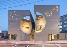 The Korean architecture firm Hoon Moon, envisioned a cultural center in the heart of the city of Ilsan, north of Seoul. The facade was engraved as a spherical vacuum and central structure was desig… Cultural Architecture, Cabinet D Architecture, Modern Architecture Design, Futuristic Architecture, Beautiful Architecture, Residential Architecture, Interior Architecture, Building Architecture, Modern Design