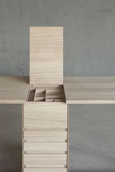 """The composition of the stocking system is composed by five drawers of different measure on the frontal part; a 'case tool' thought for pencils, pens, rubber, ruler... removable with underlying space; and an open greater space in the back part of the central column."" says designer Giulio Parini."