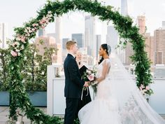 5/19/17: Jessica & Larry, Tribeca Rooftop NYC wedding Photo: The Hons  Floral Arch: Gardenia Organic Planner: Your Runway