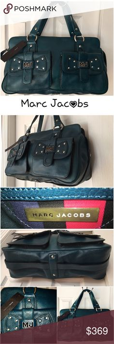 """Authentic Marc Jacobs Italian Leather Shoulder bag Convenient and edgy, this spacious, structured leather tote  is designed with twin front pockets compartments for easy access securing your essentials. Comfortable rolled 7.5"""" drop top handles provide carrying versatility, while a sleek logo adds signature style. Zip top Closure Interior zip, smartphone pockets-Protective metal feet - Gorgeous signature Lining - brand new condition. Tags attached and original MJ dust bag included. This is a…"""