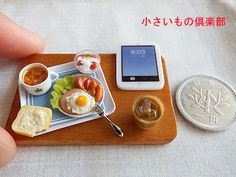 So many gorgeous food miniatures, but this stands out for the addition of the iPad.