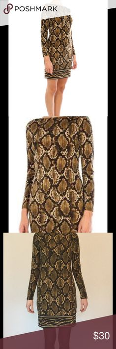 NWT Michael Kors python tiger shift dress This dress is great... slinky material that NEVER wrinkles. Its a shift style that still hugs curves and shows some shape. Boatneck collar and comfortable long sleeves. NWT... bought for vegas but never worn. Michael Kors Dresses