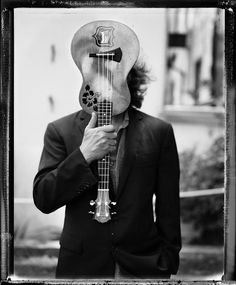 Eddie Vedder with his first instrument: a beat-up ukulele.