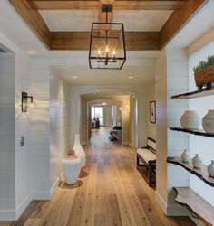 Color theme. White with raw wood accents. Wood beams, wood flooring, rustic lighting. Clean, bright, open, and airy, yet cozy and comfortable.