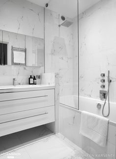 The marble invites in this bathroom for a contrasting atmosphere. Source by