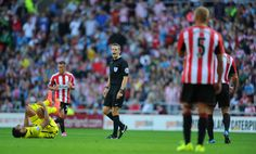 Referee Craig Pawson in action during the Barclays Premier League match between Sunderland and Tottenham Hotspur at Stadium of Light on September 13, 2014 in Sunderland, England.