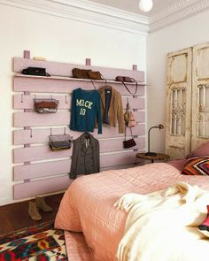 """pallet wall storage, I would use it as a """"current favorites"""" wall -- the clothes/jackets/purse that I reach for the most that week"""