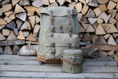 A set of Swiss Army items, consisting of a 1959 Swiss Army backpack and a metal food canister.Included in this offer is an additional leather strap, which can be used to attach the canister, or other items to the backpack. The sturdy salt and pepper canvas rucksack has metal reinforcements, a leather bottom and strong cotton inner liner. Swiss Army Backpack, Food Canisters, Vintage Backpacks, Have Metal, Leather Conditioner, Pepper, Salt, Strong, Canvas