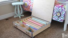 Build a gift wrap organizer to store wrapping paper, ribbons, bows, tape, scissors, etc. It easily rolls under the bed and has a large top to wrap on.
