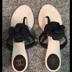 Chanel Camellia Sandals 38 Chanel Camellia Cream/Black Flip Flops Sandals Size 38                          Authentic Chanel Camellia rubber flip flops size 38. Very good condition, barely worn. Comes without box and no dust bag.   Guaranteed to be authentic. Originally purchased at Saks. CHANEL Shoes Sandals