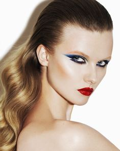 1980's Style Electric Blue Cat Eyes, & Red Lips. Editorial Makeup.