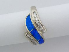 925 Sterling Silver Ring with Blue Opal and clear Cubic Zirconia. This beautiful ring weights 5 gram, and it is size Women's Jewelry, Womens Jewelry Rings, Silver Jewelry, Blue Opal Ring, Opal Rings, Opals, Orange Yellow, Ranges, Beautiful Rings