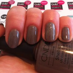 My MiniNails with CND Shellac in Rubble (March 2012 shade). With a layering of Gold VIP Status (also a new March shade) to set off the ring finger delicately but definately.  By Louise@ShineNails