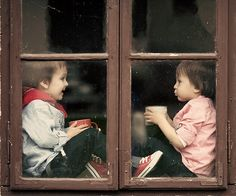Chit-chat - Two boys on the window