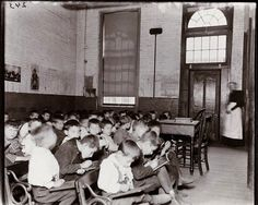 Journalist and social reformer Jacob Riis took these photos of Lower East Side kids crammed into a desk-less, crowded, all-boy classroom at the Essex Market School. This school appears to have been...