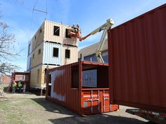 Revitalizing a tired city: Condos from Shipping containers. Workers from CDSG construction work on the ThreeSquared