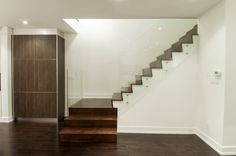 dark wood staircase with glass