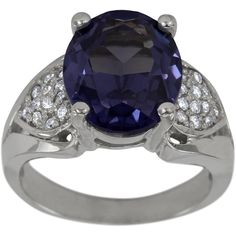 Classic Diamond Ring With Oval Amethyst Center -  This amethyst diamond ring is set with a 4.50ct oval purple amethyst center and further adorned with 0.35cts of brilliant round accent diamonds.   This classic design has a striking silhouette, which is enhanced by heart shape pavé sections filled with sparkling diamonds on either side of the oval center stone. The sleek lines of the shank end at four substantial prongs.   Dacarli has been manufacturing diamond jewelry for three...