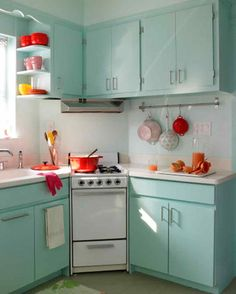 …that became a turquoise and red paradise for its owners. | 19 Unbelievable Real-Life Kitchen Transformations