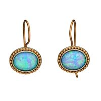 The natural twinkle of these opal earrings, inlaid in gold-filled, imitate the shine of a fresh spring morning.   #jewelry #fashionjewelry #Israel #contemporaryfashionjewelry #contemporaryjewelry #rings #necklaces #bracelets #earrings #goldjewelry #silverjewelry #sterlingsilver #semipreciousgems #gems #leather #metalworking #handmade #handcrafted #pearls #garnets #opal #turquoise #gold #silver #14k