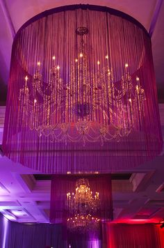 Surrounded by fringe, this grand chandelier is instantly dramatized.