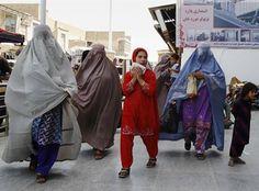 Afghan women walk in downtown Kandahar city, south of Kabul, Afghanistan