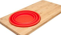 Why+settle+for+one+kitchen+tool+when+you+can+have+two+in+one+space-saving+design? Cutting Board + Colander = Your New Favorite Multitasker