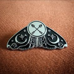 "Midnight Moth: 1.5"" black & high polish silver enamel pin comes with card and metal clutch backing."