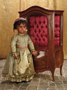 A Matter of Circumstance: 6 French Bisque Bebe Jumeau with Amber Brown Complexion and Original Costume
