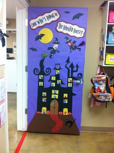 "Robins Halloween Door!! ""Look who's hiding in the Haunted House!"" With Miss Nova & Miss Sabrina as the witches on broomsticks! &&We placed 3rd in the door decorating contest!!"