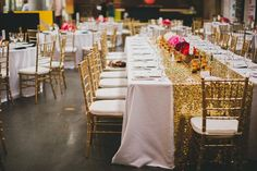 love the gold runner cloth on the white table cloth