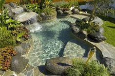 Small wading pool with waterfall and rock features. Want to go for a swim right now, lol.
