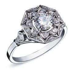 MAAYANE : Bague style Art Deco en or blanc sertie d'un diamant rond au centre et un entourage serti de diamants #bague #orblanc #diamants #bijoux #luxe #valeriedanenberg #artdeco #mariage