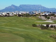 The world heritage site of Table Mountain looking down on the 18th Faiirway of the Estate