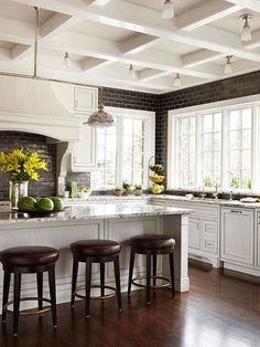 This timeless kitchen has a coffered ceiling. Do you know how that differs from a tray ceiling?